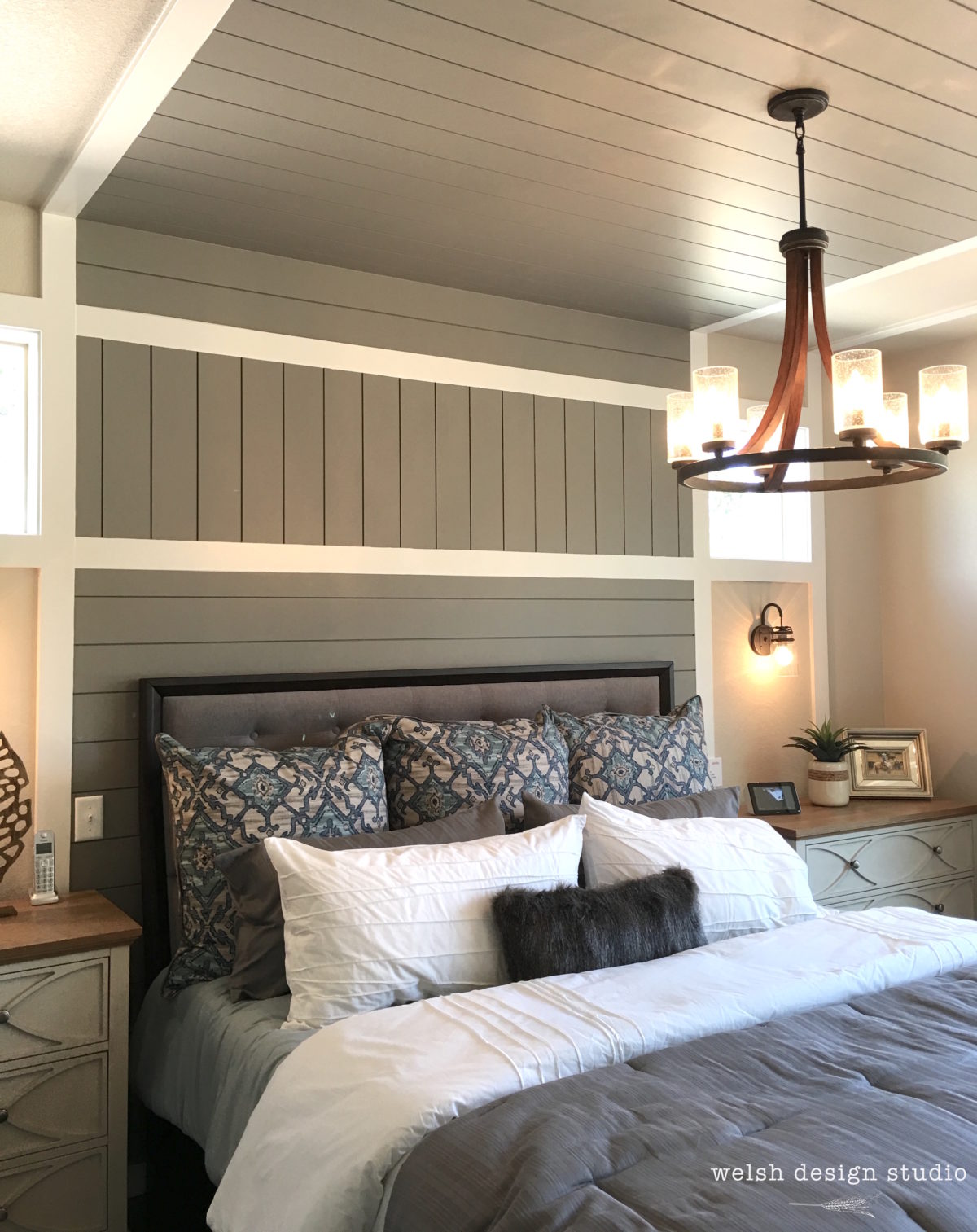 painted shiplap behind bed